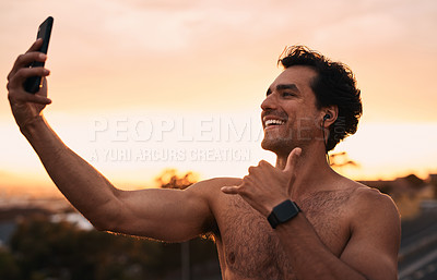 Buy stock photo Shot of a young man taking selfies during a workout in the city