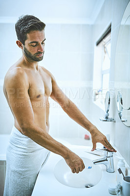 Buy stock photo Cropped shot of a handsome young man getting ready to brush his teeth in the bathroom at home