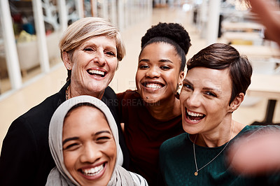 Buy stock photo Portrait of a group of businesswomen taking selfies together in an office