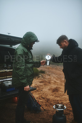Buy stock photo Shot of two male friends having fresh coffee before hiking