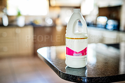 Buy stock photo Still life shot of a bottle of cleaning detergent placed on a counter in a kitchen during the day