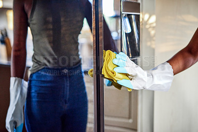 Buy stock photo Cropped shot of an unrecognizable woman cleaning her refrigerator in her kitchen at home
