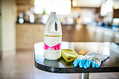 Buy stock photo Still life shot of a bottle of cleaning detergent and cleaning equipment placed on a counter in a kitchen during the day