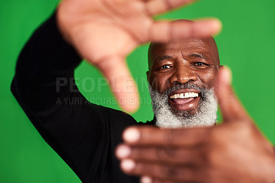 Buy stock photo Studio shot of a senior man forming a finger frame in front of his face