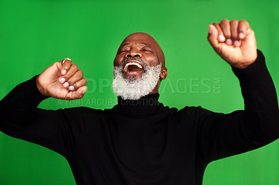 Buy stock photo Cropped shot of a senior man dancing against a green background