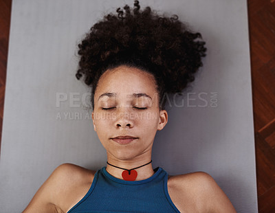 Buy stock photo Shot of a young woman resting after her yoga session