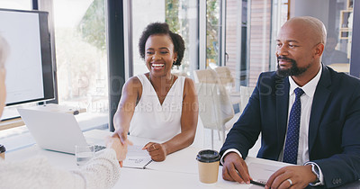 Buy stock photo Cropped shot of a diverse group of businesspeople sitting together and shaking hands during a successful meeting in the office