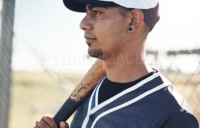 Buy stock photo Shot of a young man holding his bat at a baseball game