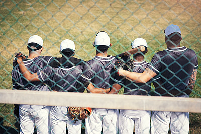 Buy stock photo Rearview shot of a group of young men standing together in solidarity at a baseball game