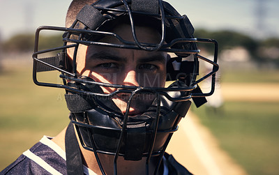 Buy stock photo Portrait of a young man wearing a catchers helmet while playing a game of baseball