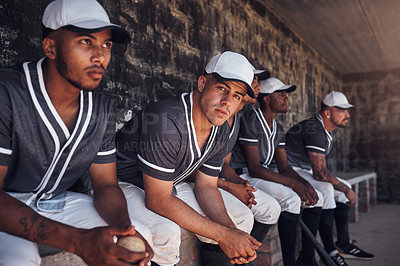 Buy stock photo Shot of a group of young men watching a game of baseball from the dugout