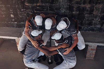 Buy stock photo Shot of a group of young men huddled together at a baseball game