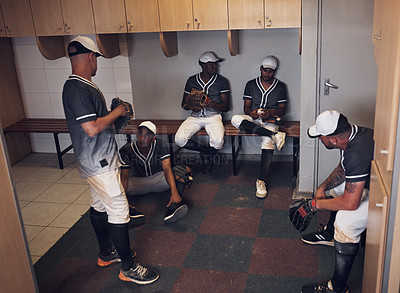 Buy stock photo Shot of a group of young men gathered in a locker room at a baseball game