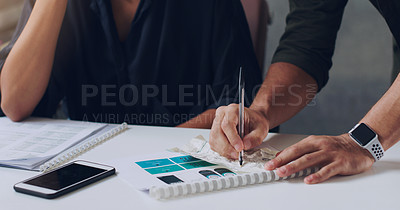 Buy stock photo Cropped shot of two unrecognizable businesspeople working together in the office