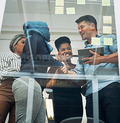 Buy stock photo Shot of a group of businesspeople applauding their colleagues while brainstorming on a glass wall in an office