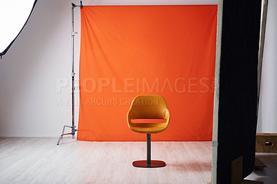 Buy stock photo Shot of a studio all set for a photo shoot against a red background