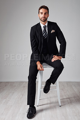 Buy stock photo Studio portrait of a handsome and stylish young man against a grey background