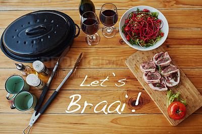 "Buy stock photo Shot of delicious food with the words ""Let's braai"" over it"