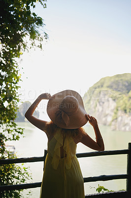 Buy stock photo Rearview shot of a young woman enjoying a vacation in Vietnam