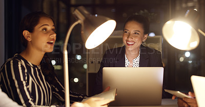 Buy stock photo Shot of a young businesswoman having a meeting with her colleagues in an office at night