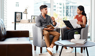 Buy stock photo Shot of two young designers having a discussion in an office