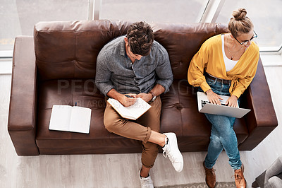 Buy stock photo High angle shot of two designers sitting on a couch in an office