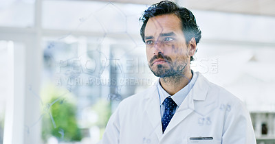 Buy stock photo Shot of a young scientist analysing notes on a glass wall in a lab