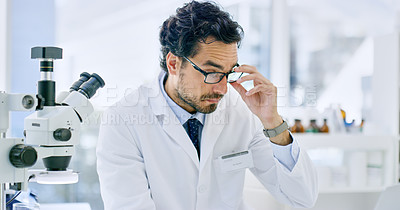 Buy stock photo Shot of a young scientist working in a lab