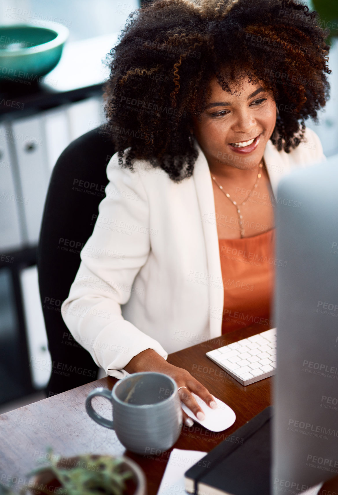 Buy stock photo Cropped shot of a young businesswoman working at her desk