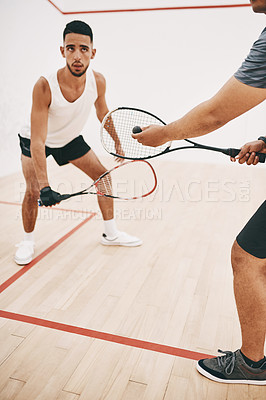 Buy stock photo Shot of two young men playing a game of squash