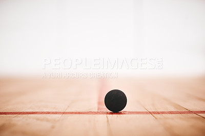 Buy stock photo Shot of a squash ball on the floor of a squash court