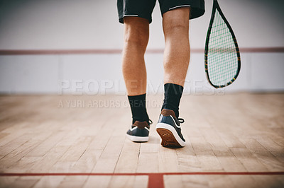Buy stock photo Cropped shot of an unrecognisable man playing a game of squash