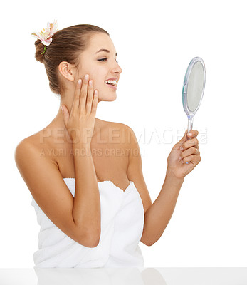 Buy stock photo A beautiful young woman checking her face in the mirror