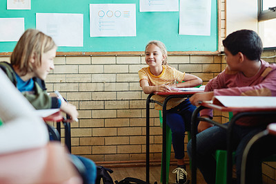 Buy stock photo Shot of a group of children talking in a classroom