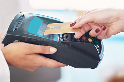 Buy stock photo Cropped shot of a customer using her credit card to make a payment