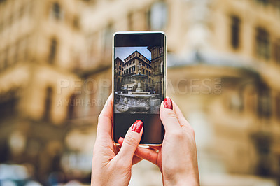Buy stock photo Cropped shot of an unrecognizable woman taking pictures while exploring a foreign city
