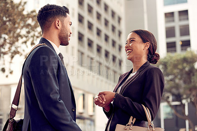 Buy stock photo Shot of two businesspeople having a discussion while out in the city