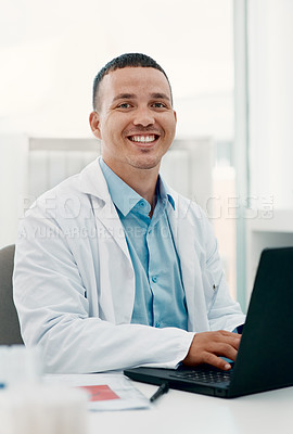 Buy stock photo Portrait of a young scientist using a laptop while working in a laboratory