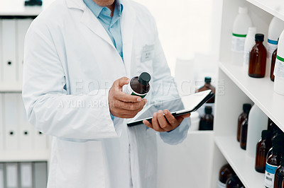 Buy stock photo Cropped of a scientist using a digital tablet while analysing medication in a laboratory