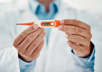 Buy stock photo Cropped shot of a doctor holding a thermometer that reads 42.8 degrees centigrade