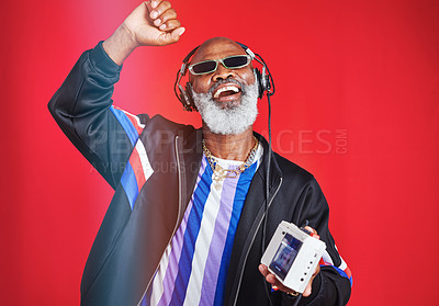 Buy stock photo Shot of a mature man listening to music through headphones