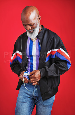 Buy stock photo Shot of a mature man using his t-shirt to clean his glasses