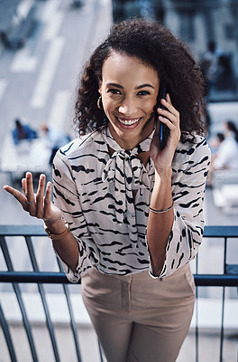 Buy stock photo Shot of a young businesswoman using a smartphone on the stairs of a modern office
