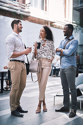 Buy stock photo Shot of a group of young businesspeople having a discussion at a convention centre