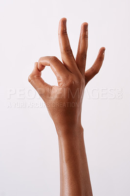 Buy stock photo Studio shot of an unrecognizable woman making an okay gesture against a white background
