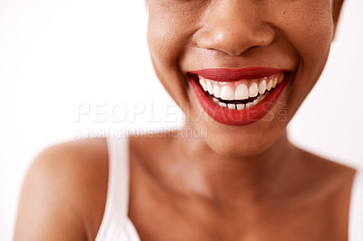 Buy stock photo Studio shot of an unrecognizable woman wearing red lipstick against a white background