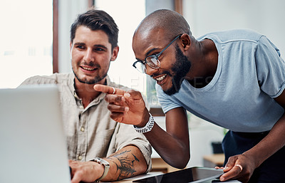 Buy stock photo Cropped shot of a handsome young businessman helping a male colleague in the office