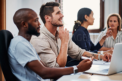 Buy stock photo Cropped shot of a group of business colleagues having a strategy meeting in the boardroom