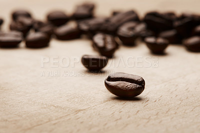Buy stock photo Still life shot of coffee beans on a wooden countertop