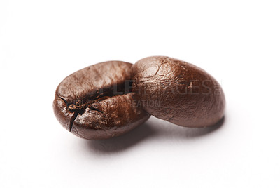 Buy stock photo Studio shot of coffee beans against a white background